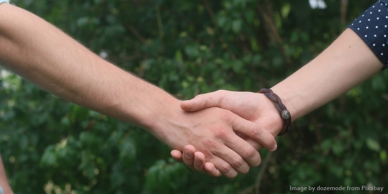 Photo of friends holding hands