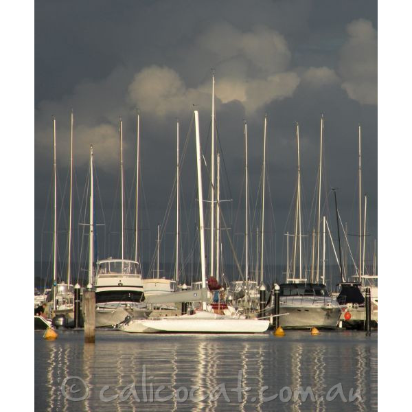 Photo of yachts with dark grey sky